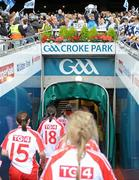 26 September 2010; The Tyrone team go back to the dressing-room as the Dublin players lift the Brendan Martin Cup. TG4 All-Ireland Senior Ladies Football Championship Final, Dublin v Tyrone, Croke Park, Dublin. Picture credit: Dáire Brennan / SPORTSFILE