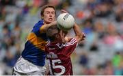 31 July 2016; Brian Fox of Tipperary in action against Danny Cummins  of Galway during the GAA Football All-Ireland Senior Championship Quarter-Final match between Galway and Tipperary at Croke Park in Dublin. Photo by Piaras Ó Mídheach/Sportsfile