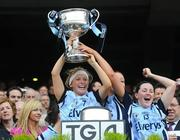 26 September 2010; Gemma Fay, Dublin, lifts the Brendan Martin Cup. TG4 All-Ireland Senior Ladies Football Championship Final, Dublin v Tyrone, Croke Park, Dublin. Picture credit: Dáire Brennan / SPORTSFILE