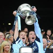 26 September 2010; Dublin players Karen Kennedy, left, lifts the Brendan Martin Cup with her Naomh Mearnóg clubmate Clíodhna O'Connor. TG4 All-Ireland Senior Ladies Football Championship Final, Dublin v Tyrone, Croke Park, Dublin. Picture credit: Dáire Brennan / SPORTSFILE