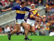 12 August 2001; John Carroll, Tipperary, in action against Rory McCarthy, Wexford. Tipperary v Wexford, Guinness All-Ireland Hurling Championship Semi-final, Croke Park, Dublin. Picture credit; Ray McManus / SPORTSFILE