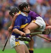 12 August 2001; Rory McCarthy, Wexford is tackled by Philip Maher, Tipperary, Tipperary v Wexford, Guinness All-Ireland Hurling Championship Semi-Final, Croke Park, Dublin. Picture credit; Damien Eagers / SPORTSFILE