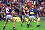 12 August 2001; Garry Laffan, Wexford, passes the ball to team-mate Rory McCarthy, left, as Tipperary's Eamon Corcoran comes to challenge. Tipperary v Wexford, Guinness All-Ireland Hurling Championship Semi-Final, Croke Park, Dublin. Picture credit; Brian Lawless / SPORTSFILE