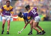 12 August 2001; Thomas Dunne, Tipperary, in action against Rory McCarthy, Wexford. Tipperary v Wexford, Guinness All-Ireland Hurling Championship Semi-Final, Croke Park, Dublin. Picture credit; Damien Eagers / SPORTSFILE