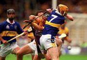 12 August 2001; Wexford's Rory McCarthy looses his hurley in a tustle with Tipperary's Eamonn Corcoran. Tipperary v Wexford, Guinness All-Ireland Hurling Championship Semi-Final, Croke Park, Dublin. Picture credit; Damien Eagers / SPORTSFILE