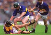 12 August 2001; Rory McCarthy, Wexford, in action against Tipperary's David Kennedy. Tipperary v Wexford, Guinness All-Ireland Hurling Championship Semi-Final, Croke Park, Dublin. Picture credit; Ray McManus / SPORTSFILE