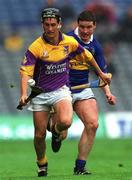 18 August 2001; Rory McCarthy, Wexford, in action against John Carroll, Tipperary. Wexford v Tipperary, Guinness All-Ireland Hurling Championship Semi-Final Replay, Croke Park, Dublin. Picture credit; Ray McManus / SPORTSFILE