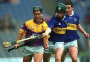 18 August 2001; Rory McCarthy, Wexford, in action against David Kennedy, Tipperary. Wexford v Tipperary, Guinness All-Ireland Hurling Championship Semi-Final Replay, Croke Park, Dublin. Picture credit; Ray McManus / SPORTSFILE