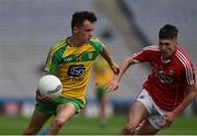 30 July 2016; Eoghan McGettigan of Donegal in action against Aidan Browne of Cork during the Electric Ireland GAA Football All-Ireland Minor Championship Quarter-Final match between Donegal and Cork at Croke Park in Dublin. Photo by Ray McManus/Sportsfile