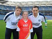 27 September 2010; Layla Alvey, from Donegal, with Kildare manager Kieran McGeeney and Cavan footballer Paul Brady. Vhi GAA Cúl Day Out 2010, Croke Park, Dublin. Picture credit: Oliver McVeigh / SPORTSFILE