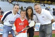 27 September 2010; Ciaran Doyle, from Offaly, with Tipperary hurler Eoin Kelly, Wexford camogie player Mags D'Arcy, and Declan Moran, Director of Marketing and Business Development Vhi. Vhi GAA Cúl Day Out 2010, Croke Park, Dublin. Picture credit: Oliver McVeigh / SPORTSFILE