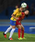 3 August 2016; Tamires of Brazil in action against Li Yang of China during the Women's Football first round Group E match between Brazil and China on Day -2 of the Rio 2016 Olympic Games  at the Olympic Stadium in Rio de Janeiro, Brazil. Photo by Stephen McCarthy/Sportsfile