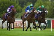 4 August 2016; Eventual winner Stellar Mass, centre, with Kevin Manning up, race ahead of Almela, eventual second place, with Pat Smullen up, and Bondi Beach, eventual third place, with Seamie Heffernan up, on their way to winning the Ballyroan Stakes during the Bulmers Evening Meeting at Leopardstown in Dublin.  Photo by Cody Glenn/Sportsfile