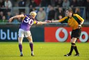10 October 2010; Mark Vaughan, Kilmacud Crokes, gives his substitutes slip to referee Brian O'Shea during the second half. Dublin County Senior Football Championship Semi-Final, Kilmacud Crokes v St Vincent's, Parnell Park, Dublin. Picture credit: Stephen McCarthy / SPORTSFILE