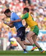 6 August 2016; Michael Darragh Macauley of Dublin in action against Karl Lacey of Donegal during the GAA Football All-Ireland Senior Championship Quarter-Final match between Dublin and Donegal at Croke Park in Dublin. Photo by Piaras Ó Mídheach/Sportsfile