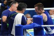 7 August 2016; Steven Donnelly of Ireland in conversation with coaches Zaur Antia, left, and John Conlan, centre, after defeating Zohir Kedache of Algeria in their Welterweight preliminary round of 32 bout in the Riocentro Pavillion 6 Arena, Barra da Tijuca, during the 2016 Rio Summer Olympic Games in Rio de Janeiro, Brazil. Photo by Ramsey Cardy/Sportsfile