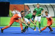 7 August 2016; Jonathan Bell of Ireland in action against Bob de Voogd, left, and Jorrit Croon of Netherlands during their Pool B match at the Olympic Hockey Centre, Deodoro, during the 2016 Rio Summer Olympic Games in Rio de Janeiro, Brazil. Picture by Brendan Moran/Sportsfile