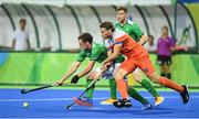 7 August 2016; Jonathan Bell of Ireland in action against Bob de Voogd of Netherlands during their Pool B match at the Olympic Hockey Centre, Deodoro, during the 2016 Rio Summer Olympic Games in Rio de Janeiro, Brazil. Picture by Brendan Moran/Sportsfile