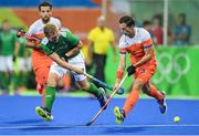 7 August 2016; Michael Watt of Ireland in action against Sander Baart of Netherlands during their Pool B match at the Olympic Hockey Centre, Deodoro, during the 2016 Rio Summer Olympic Games in Rio de Janeiro, Brazil. Picture by Brendan Moran/Sportsfile