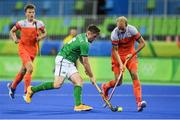 7 August 2016; Shane O'Donoghue of Ireland in action against Billy Bakker of Netherlands during their Pool B match at the Olympic Hockey Centre, Deodoro, during the 2016 Rio Summer Olympic Games in Rio de Janeiro, Brazil. Picture by Brendan Moran/Sportsfile