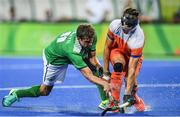 7 August 2016; John Jermyn of Ireland in action against Sander de Wijn of Netherlands during their Pool B match at the Olympic Hockey Centre, Deodoro, during the 2016 Rio Summer Olympic Games in Rio de Janeiro, Brazil. Picture by Brendan Moran/Sportsfile