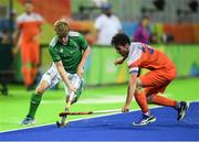 7 August 2016; Kirk Shimmins of Ireland in action against Robert van der Horst of Netherlands during their Pool B match at the Olympic Hockey Centre, Deodoro, during the 2016 Rio Summer Olympic Games in Rio de Janeiro, Brazil. Picture by Brendan Moran/Sportsfile