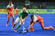 7 August 2016; Peter Caruth of Ireland in action against Sander de Wijn of Netherlands of Netherlands during their Pool B match at the Olympic Hockey Centre, Deodoro, during the 2016 Rio Summer Olympic Games in Rio de Janeiro, Brazil. Picture by Brendan Moran/Sportsfile