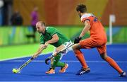 7 August 2016; Peter Caruth of Ireland in action against Hidde Turkstra of Netherlands during their Pool B match at the Olympic Hockey Centre, Deodoro, during the 2016 Rio Summer Olympic Games in Rio de Janeiro, Brazil. Picture by Brendan Moran/Sportsfile