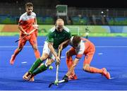 7 August 2016; Peter Caruth of Ireland in action against Sander de Wijn of Netherlands during their Pool B match at the Olympic Hockey Centre, Deodoro, during the 2016 Rio Summer Olympic Games in Rio de Janeiro, Brazil. Photo by Brendan Moran/Sportsfile