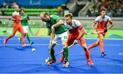 7 August 2016; Peter Caruth of Ireland in action against Mink van der Weerden of Netherlands during their Pool B match at the Olympic Hockey Centre, Deodoro, during the 2016 Rio Summer Olympic Games in Rio de Janeiro, Brazil. Photo by Brendan Moran/Sportsfile