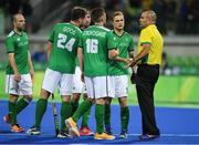 7 August 2016; Ireland players speak to umpire Nathan Stagno after their Pool B match against the Netherlands at the Olympic Hockey Centre, Deodoro, during the 2016 Rio Summer Olympic Games in Rio de Janeiro, Brazil. Photo by Brendan Moran/Sportsfile