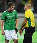 7 August 2016; Kyle Good of Ireland speaks to umpire Nathan Stagno after their Pool B match against the Netherlands at the Olympic Hockey Centre, Deodoro, during the 2016 Rio Summer Olympic Games in Rio de Janeiro, Brazil. Photo by Brendan Moran/Sportsfile