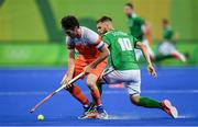 7 August 2016; Robert van der Horst of Netherlands in action against Alan Sothern of Ireland during their Pool B match at the Olympic Hockey Centre, Deodoro, during the 2016 Rio Summer Olympic Games in Rio de Janeiro, Brazil. Photo by Brendan Moran/Sportsfile