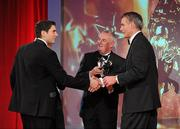 15 October 2010; Bernard Brogan, Dublin, is presented with his GAA Football All-Star Player of the Year award by Uachtarán Chumann Lúthchleas Gael Criostóir Ó Cuana, and Jeroen Hoencamp, CEO, Vodafone Ireland, during the 2010 GAA All-Stars Awards, sponsored by Vodafone. Citywest Hotel & Conference Centre, Saggart, Co. Dublin. Picture credit: Brendan Moran / SPORTSFILE