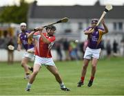 9 August 2016; Former Limerick manager and player TJ Ryan in action against former Kilkenny player DJ Carey during the fifth annual Hurling for Cancer Research, a celebrity hurling match in aid of the Irish Cancer Society in St Conleth's Park, Newbridge. Ireland's top GAA and horseracing stars lined out for the game, organised by horseracing trainer Jim Bolger and National Hunt jockey Davy Russell. To date the event has raised €400,000 for the Irish Cancer Society, the leading voluntary funder of cancer research in Ireland. St Conleth's Park, Newbridge, Kildare. Photo by David Maher/Sportsfile