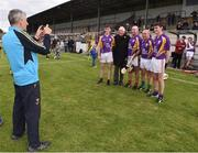 9 August 2016; Former Wexford manager Liam Griffin takes a photograph of Ronnie Delany, winner of the gold medal in the 1,500m in the 1956 Olympic Games in Melbourne, Australia with former Kilkenny players including DJ Carey and Charlie Carter  pictured at the fifth annual Hurling for Cancer Research, a celebrity hurling match in aid of the Irish Cancer Society in St Conleth's Park, Newbridge. Ireland's top GAA and horseracing stars lined out for the game, organised by horseracing trainer Jim Bolger and National Hunt jockey Davy Russell. To date the event has raised €400,000 for the Irish Cancer Society, the leading voluntary funder of cancer research in Ireland. St Conleth's Park, Newbridge, Kildare. Photo by David Maher/Sportsfile