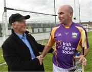 9 August 2016; Former Kilkenny player DJ Carey pictured with Paddy Timmons of the Sarsfield GAA Club at the fifth annual Hurling for Cancer Research, a celebrity hurling match in aid of the Irish Cancer Society in St Conleth's Park, Newbridge.   Ireland's top GAA and horseracing stars lined out for the game, organised by horseracing trainer Jim Bolger and National Hunt jockey Davy Russell. To date the event has raised €400,000 for the Irish Cancer Society, the leading voluntary funder of cancer research in Ireland. St Conleth's Park, Newbridge, Kildare. Photo by David Maher/Sportsfile