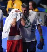 9 August 2016; David Oliver Joyce of Ireland is consoled by coach John Conlan after his defeat to Albert Selimov of Azerbaijan in their Lightweight preliminary round of 32 bout in the Riocentro Pavillion 6 Arena, Barra da Tijuca, during the 2016 Rio Summer Olympic Games in Rio de Janeiro, Brazil. Photo by Ramsey Cardy/Sportsfile