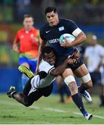 9 August 2016; Axel Muller of Argentina is tackled by Jerry Tuwai of Fiji during the Men's Pool A Rugby Sevens match between Fiji and Argentina at the Deodoro Stadium during the 2016 Rio Summer Olympic Games in Rio de Janeiro, Brazil. Photo by Stephen McCarthy/Sportsfile