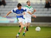 24 October 2010; Craig Rogers, Portlaoise, shoots to score his side's second goal. AIB GAA Football Leinster Club Senior Championship Quarter-Final, Moorefield v Portlaoise, O'Moore Park, Portlaoise, Co. Laois. Picture credit: Stephen McCarthy / SPORTSFILE