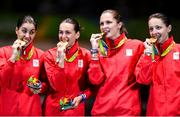 11 August 2016; The Romania team on the podium following their victory in the Women's Épée Team Gold Medal Match in Carioca Arena 3 during the 2016 Rio Summer Olympic Games in Rio de Janeiro, Brazil. Photo by Ramsey Cardy/Sportsfile