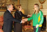 27 October 2010; TEAM Ireland member Siobhan Dunne, from Strabane, Co. Tyrone, who earned a 4th place ribbon in the Women's 7-aside football at the 2010 Special Olympics European Games, with President Mary McAleese and Dr. Martin McAleese at a reception to celebrate their achievements in Aras an Uachtarain, Phoenix Park, Dublin. Picture credit: Ray McManus / SPORTSFILE