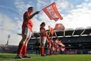 26 September 2010; A general view of flagbearers as the Louth team run out onto the pitch before the game. TG4 All-Ireland Junior Ladies Football Championship Final, Louth v Limerick, Croke Park, Dublin. Picture credit: Brendan Moran / SPORTSFILE