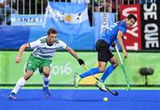 12 August 2016; Jonathan Bell of Ireland in action against Matias Rey of Argentina during the Pool B match between Ireland and Argentina at the Olympic Hockey Centre, Deodoro, during the 2016 Rio Summer Olympic Games in Rio de Janeiro, Brazil. Photo by Stephen McCarthy/Sportsfile