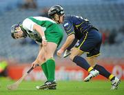 30 October 2010; Jackie Tyrrell, Ireland, in action against Finlay Macraey, Scotland. Senior Hurling / Shinty International 1st Test, Ireland v Scotland, Croke Park, Dublin. Picture credit:  Stephen McCarthy / SPORTSFILE