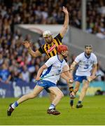13 August 2016; Tadhg de Búrca of Waterford clears his lines as Michael Fennelly of Kilkenny pulls up with an injury during the GAA Hurling All-Ireland Senior Championship Semi-Final Replay game between Kilkenny and Waterford at Semple Stadium in Thurles, Co Tipperary. Photo by Piaras Ó Mídheach/Sportsfile
