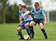 14 August 2016; Jakub Basinski of Belvedere in action against Matthew Brennan of Crumlin United during the final of the Volkswagen Junior Masters Under 13 Football Tournament at the AUL Sports Grounds, Dublin Airport, Dublin. Photo by Paul Mohan/Sportsfile