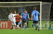 1 November 2010; Paddy Madden, Bohemians, beats Michael Leahy and goalkeeper Ger Barron, UCD, to score his side's first goal. Newstalk A Championship Final, UCD v Bohemians, Belfield Bowl, UCD, Dublin. Picture credit: David Maher / SPORTSFILE