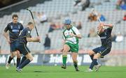 30 October 2010; Willie Hyland, Ireland, in action against Scott Campbell, left, and Paul Gow, Scotland. Senior Hurling / Shinty International 1st Test, Ireland v Scotland, Croke Park, Dublin. Picture credit: Diarmuid Greene / SPORTSFILE