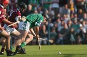 25 August 2001; Mark Keane, Limerick, goes past the Galway defence of John Culkin(4) and Michael Quinn to score his sides opening goal. Galway v Limerick, All Ireland U21 Hurling Semi Final, Ennis, Co. Clare.  Picture credit; Matt Browne / SPORTSFILE *EDI*